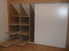 Loft Conversion - Storage in the eaves - shelves drawers for easy access to the cabinet bottom.