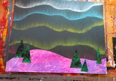 "that artist woman: Northern Lights - adds the cool land & trees with two different ""special paper"" making effects (snow is cling wrap over watercolored paper, trees are paint on textured wallpaper swatches, sponged with some black."