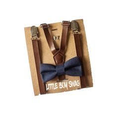 Coffee brown leather suspenders with a navy bow tie perfect look for ring bearers, birthday boys. Dress your little man up and be in the height of fashion. Perfect for birthdays, cake smash, family photos or any reason to dress up and look great!  #littleboyswag #birthday #bowtie #wedding #ringbearer