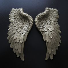 These pair of Small Golden Angel Wings make a chic decoration for the walls of your home or as a lovely gift. The wings are hand painted gold and each feather is shaped in detail, making the wings ornate and elegant.