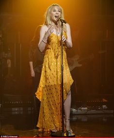 Golden girl: Kylie Minogue seemed to take inspiration from her new record when it came to her outfit choice as she performed on Late Night With Seth Meyers in New York on Wednesday