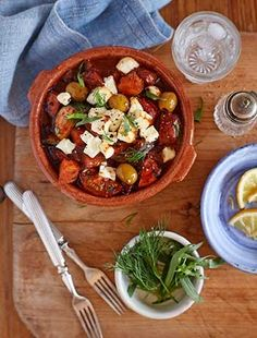 Baked feta with tomatoes and red wine