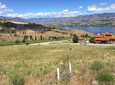 Panoramic view lot at Bear Mountain Ranch Golf Course community. One of two adjacent lots over a third of an acre to build your dream home. This desirable neighborhood offers huge views of Lake Chelan and the surrounding mountains overlooking Bear Mountain Golf course for your year around pleasure. Adjoining lot available to protect your view or grow your vineyard. Bear Mountain, Vacant Land, Build Your Dream Home, Acre, Dreaming Of You, Ranch, Vineyard, Golf Courses, Third