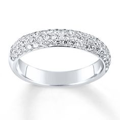 Closely nestled round diamonds follow every curve of this elegant anniversary band for her. Fashioned in 14K white gold, the band has a total diamond weight of 5/8 carat. Diamond Total Carat Weight may range from .58 - .68 carats.