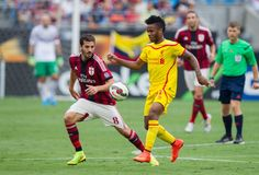 Raheem Sterling #31 of Liverpool controls the ball in front of Riccardo Saponara #8 of A.C. Milan during first half action in the Guinness International Champions Cup at Bank of America Stadium on August 2, 2014 in Charlotte, North Carolina. Liverpool defeated A.C. Milan 2-0