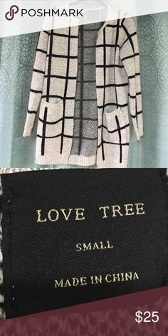 Cute sweater black and grey Pre worn. Perfect to pair with plain shirt with dark jeans or leggings and a good pair of heals! Very classy/ chic . love tree Sweaters Cardigans