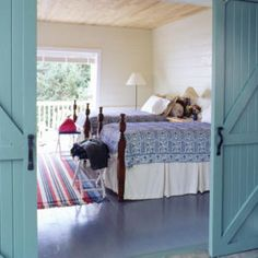 Nova Scotia Nautical | Love the quilts and barn doors (and colors too).