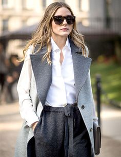Queen of perfect personal style, Olivia Palermo, recently stepped out in a sleeveless waistcoat worn over a classic black-and-white ensemble. #InStyle