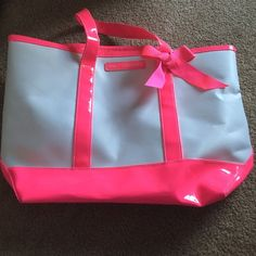 Juicy Couture Tote/Beach Bag It's neon pink and white! Lightly used. Two pockets inside the tote for cellphone or wallet. Juicy Couture Bags Totes