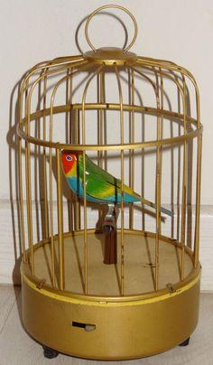 Ancienne boîte à musique cage à oiseau tôle siffleur - TBE - Années 50