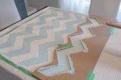 chevron rug DIY – Ikea rug, paint, cardboard stencil.