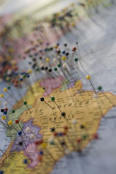enter your pin    At Dixie's BBQ in Bellevue, you are invited to put a pin on the map to show where you're from. They get so full of pins, in fact, that rather than just tear one map down and replace it, they hang those old maps up on the wall, giving you this incredible view of time and visits.