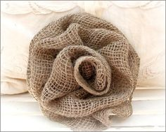 My sister found a lil web tutorial on how to make these, but I couldn't find it the exact one so I'm forgoing it with a picture of another pretty burlap rose.