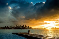 Sometimes you are lucky enough to be there for a moment || sometimes the moment have actually organised to be there and you just need to find out the time they are meeting.. My first wedding photograph - taken yesterday during the coming of a #Sydney storm from #bradleyshead at #sunset whilst shooting #timelapse by samyeldham