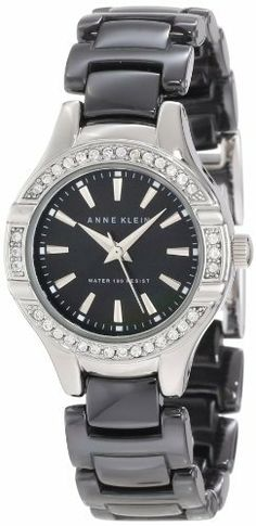 Anne Klein Women's 10/9873BMBK Swarovski Crystal Accented Silver-Tone Black Ceramic Watch Anne Klein. $123.95. Black colored genuine mother-of-pearl dial with silver-tone index markers at all hours; silver-tone hour, minute & second hands. Bezel set with 36 clear genuine Swarovski crystals. 26 mm round case finished in polished silver-tone. Black adjustable link ceramic bracelet with silver-tone jewelry clasp closure and extender. Water-resistant to 100 M (330 feet)