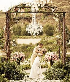 simple arch. just create a  12 foot structure, pile it with vines and flowers, add a crystal chandelier and two huge flower displays, add a few large shrubberies and we're in business!