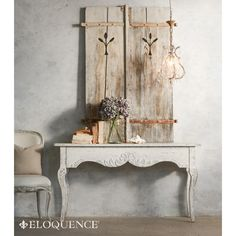 New! The Eloquence Rococo Console Table. Gorgeous as a display piece to show off your fresh cut flowers, or fantastic as a grand vanity or writing desk! A concealed drawer in front gives ample storage space. Opulent carved floral detailing. In weathered Storm Cloud White finish.