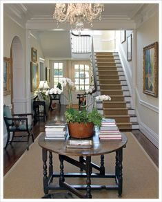 Round antique table - great choice for a wide entryway/foyer to be accessorized for a great focal point.