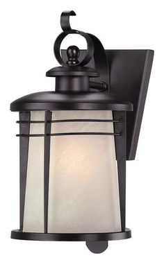 Offering traditional Craftsman style, the Senecaville one-light wall lantern will match both classic and modern decor. A white alabaster glass shade hangs from a scroll arm and pressed loop. Two slend