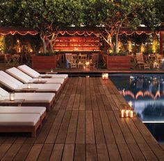 Pool Bar. Love all the lights & lanterns