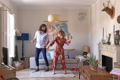 """Dora and Oliver dancing in their home in Barcelona. """"We like to be good hosts and make [friends] feel at home. As Emerson said, 'The only way to have a friend is to be one.'"""""""