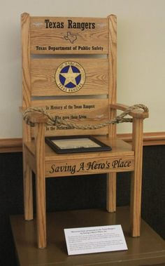 """Saving a Hero's Place is a non-profit memorial society honoring law enforcement and first responders who have given their lives in the line of duty. They provide handmade memorials, usually a symbolic """"empty chair,"""" to the agencies at which the officers served as an enduring reminder of their sacrifice. An Honor Chair memorializing all fallen Texas Rangers since 1823 was presented to the Texas Rangers during a Texas Ranger In-Service event on Wednesday, October 7, 2015."""