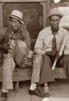 Zydeco musicians playing accordion and washboard in front of store, near New Iberia, Louisiana, 1938. Russell Lee, photographer
