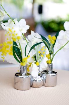 silver trio vases, white green and yellow arrangement, orchids and eucalyptus leaves, clean, modern idea  Destination wedding in Dominican Republic, florals by Soulflower Design Studio, San Francisco, come visit us at soulflowersf.com/