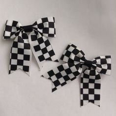 """Pair of Checkered Hair Bows A pair of checkered hair bows will dress up your hairstyle in a snap! Measures roughly 2.25"""" across. NWOT; never worn. Great for pigtails or keeping those pesky bangs out of your face! Hot Topic Accessories Hair Accessories"""