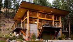 modern mountain cabin . combining  industrial materials . oxidized steel, concrete, metal mesh with timber . near Seattle