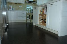 Proof that cork flooring belongs in a kitchen!  This Black Beach floating floor was installed many years ago.  It still looks like new.  A few precautions against large spills and you are ready to roll.