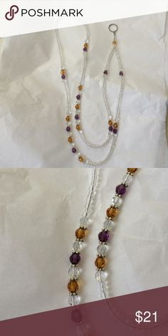 Topaz and Purple Beaded Lanyard This Lanyard is made with 6 mm Topaz Swarovski crystals and 6 mm purple Swarovski crystals, 6 mm clear round flat beads, sterling silver spacers, and small clear seed beads. Jewelry Necklaces