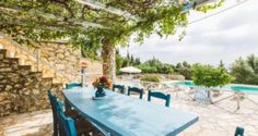 shaded outdoor seating and table in Traditional villa for 8 in North Zakynthos, Greece, near The Peligoni Club with a pool