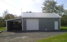"""Building Dimensions: 30' W x 32' L x 10' 4"""" H (ID# 210) 30' Standard Trusses, 4' on Center, 4/12 Pitch  Colors: Siding Color: Slate Roofing Color: Charcoal Trim Color: Brite White  For More Information: http://pioneerpolebuildings.com/portfolio/project/30-w-x-32-l-x-10-4-h-id-210-total-cost-18425  Or Call: 1-888-448-2505  Pioneer Pole Buildings, Inc. 716 South Route 183 Schuylkill Haven, PA. 17972"""