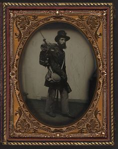 [Private Albert H. Davis of Company K, 6th New Hampshire Infantry Regiment in uniform, shoulder scales, and Hardee hat with Model 1841 Mississippi rifle, sword bayonet, knapsack with bedroll, canteen, and haversack] (LOC) by The Library of Congress, via Flickr