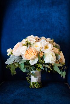 This classic bridal bouquet featured ivory and peach garden roses and spray roses with textured greenery accents. | Bob Gail Events Different Types Of Flowers, Spray Roses, Garden Roses, Groom And Groomsmen, Boutonnieres, Event Planning, Wedding Bouquets, Greenery, Floral Wreath