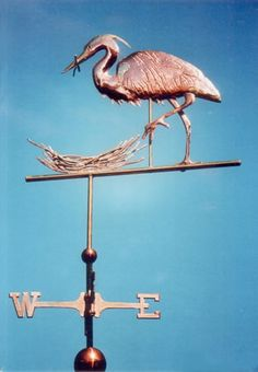 The Great Blue Heron Weather Vane with Nest, Ardea herodias, is handcrafted entirely of copper with optional gold leafing. Customization available.