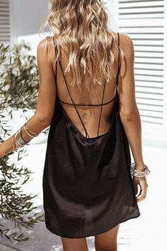 Work this seriously standout mini dress this season. It is adorned with open back and sleeveless. We love it with high heels. - Sexy style - Sleeveless - Open back - Mini length - Regular fit