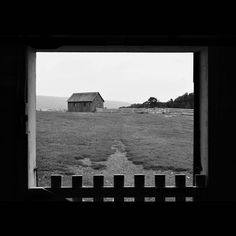 """""""#view of a #shed and #fields,  through a #doorway with a #gate,  in a #historic #barn . #hancockshakervillage #massachusetts . #blackandwhite #bw #bnw…"""""""