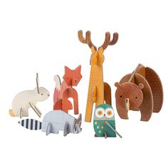 "Simple to pop together and durable enough for hours of play, this set of punch-out forest animals makes a great table-top decoration or quiet afternoon craft. Instant assembly makes it easy to create a bear, stag, fox, bunny, racoon, and owl! Each pop-out set comes with 4 pages, and each page measures 5""x7""1/8"". Made from recycled stock and printed with vegetable inks. Age: 3+"