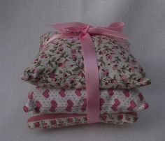 This pretty trio of pillows are handmade in a country / shabby chic cotton fabric in shades of pink & cream, floral, hearts & floral stripes and finished off with a satin ribbon. The pillows are filled with Aromatic English Lavender. The size of each cushion is approx. 9cm square. Thse lovely pillows will keep your drawers smelling nice or could be placed in a room for a lovely fresh fragrance and would make a lovely gift.  PRICE £5.00 + P&P