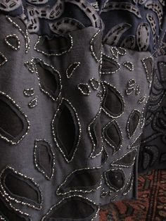 Alabama Chanin ... the beading gives an elegant touch to the black fabric