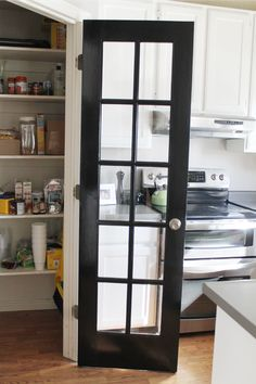 Pantry Door - this is cool in theory, but who's pantry stays neat enough to have a glass door? Frost the panes ,maybe. Ikea Kitchen Design, Kitchen Cabinet Design, Kitchen Cabinets, Kitchen Pantry Doors, Laundry Room Doors, Pantry Design, Interior Barn Doors, Diy Door, Home Kitchens