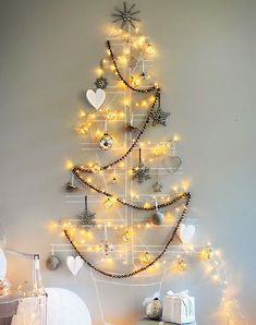 These wall trees are perfect for small spaces if you don't have enough place for real Christmas tree.
