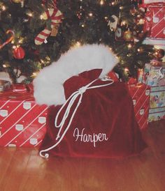This listing is for a Santa christmas bag It is made with Premium Velvet. 20x26 inches in size Comes with one of the two finishings: *Just the childs name OR To: name From: Santa Please read ALL policies before checking out Discount for multiples-message us first
