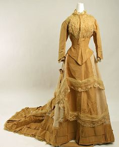 Yellow silk wedding ensemble (front), American, 1877. Worn with white leather high-button boots and cotton petticoat.