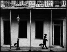Dennis Stock View profile USA. New Orleans, Louisiana. 1958. Ernest MILLER nicknamed Kid Punch MILLER trumpet player and singer returning home at 6 am.Magnum Photos -