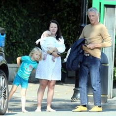 Paul Weller and his wife are seen outside their house in north London with children