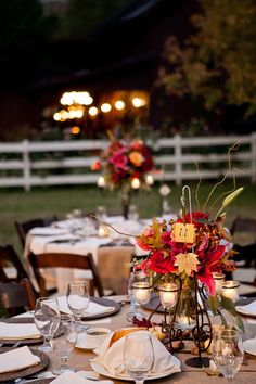 Fall Reception Centerpieces With Red Orange and Green Flowers