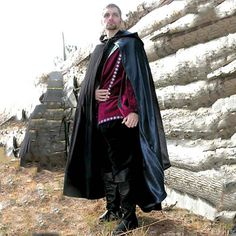 Noble Cloak $175  Wrap yourself in luxury in our Jewel Black cotton velveteen cloak. The superb cut of this cloak is made even better with tailored shoulders. Lined in Gold, Crimson or Steel Navy satin, this cloak comes with a hand-made, authentic brass reproduction cloak pin.
